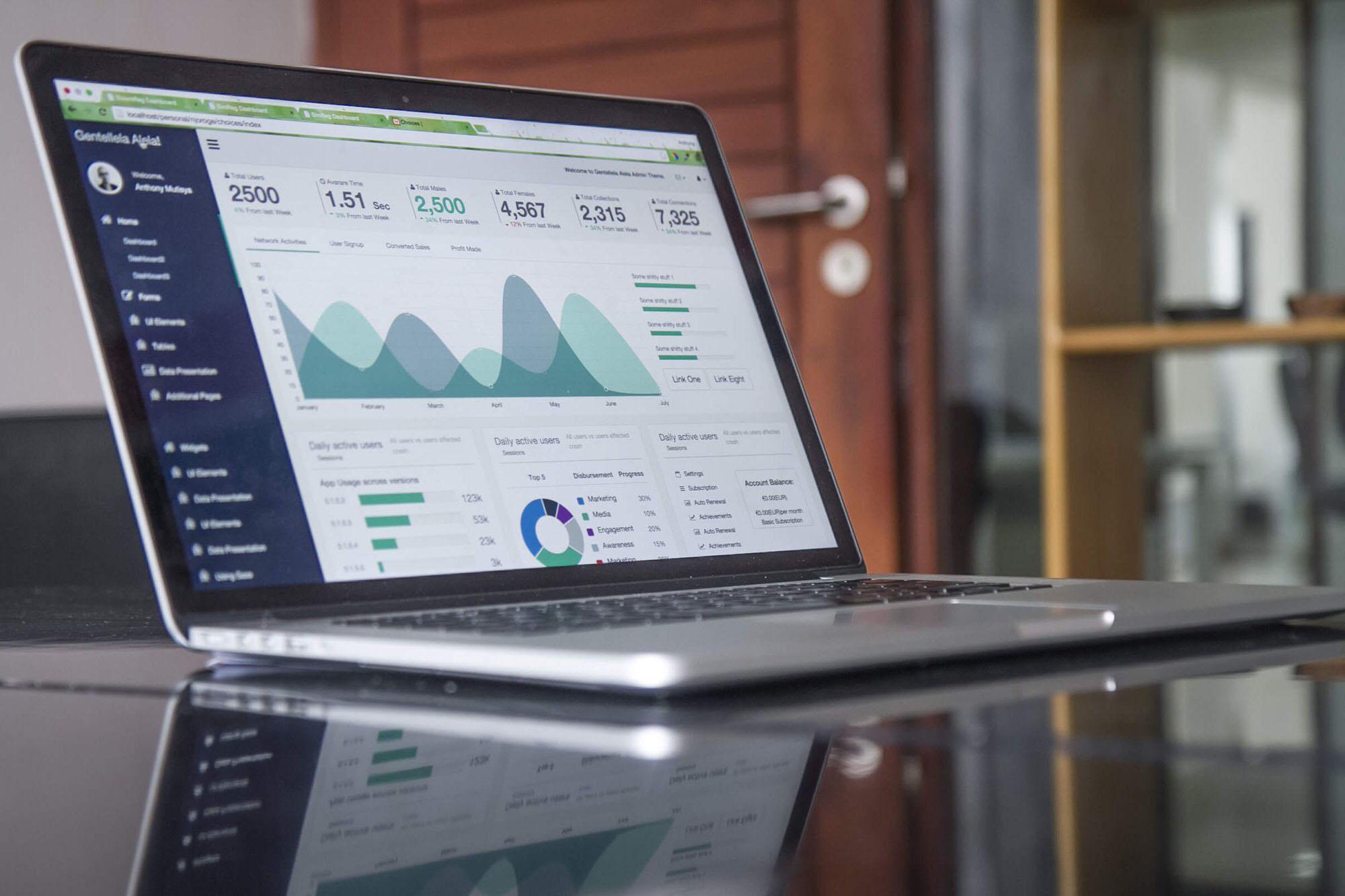 Open laptop with spreadsheet data on screen